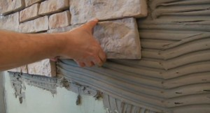 Облицовка фасада дома фасадным камнем