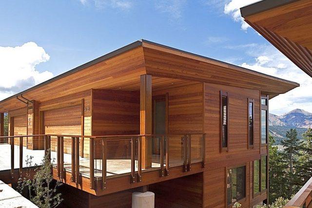 Фото дома после отделки деревянным сайдингом
