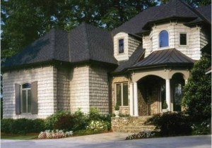 Фото дома после отделки фасада цокольным сайдингом Nailite