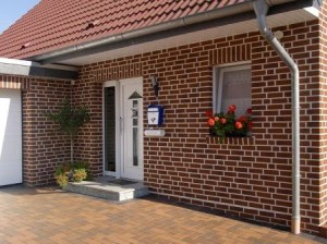Отделка фасада дома фасадными термопанелями