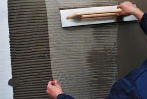 Монтаж армирующего слоя на стены дома