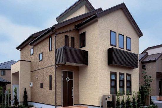 Отделка фасада дома фиброцементными панелями под камень