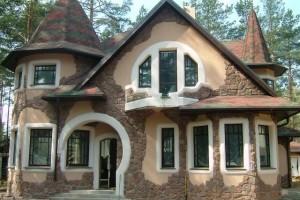 Фото дома после отделки фасада натуральным камнем и штукатуркой